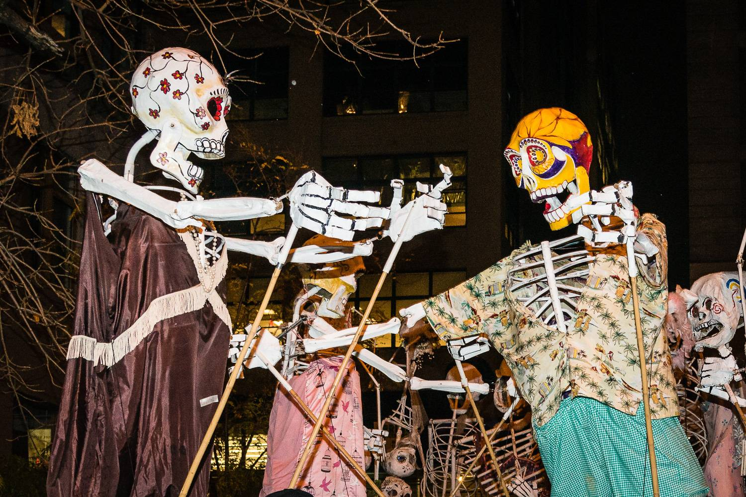 An image of painted skeletons during the Village Parade in New York City's Greenwich Village.