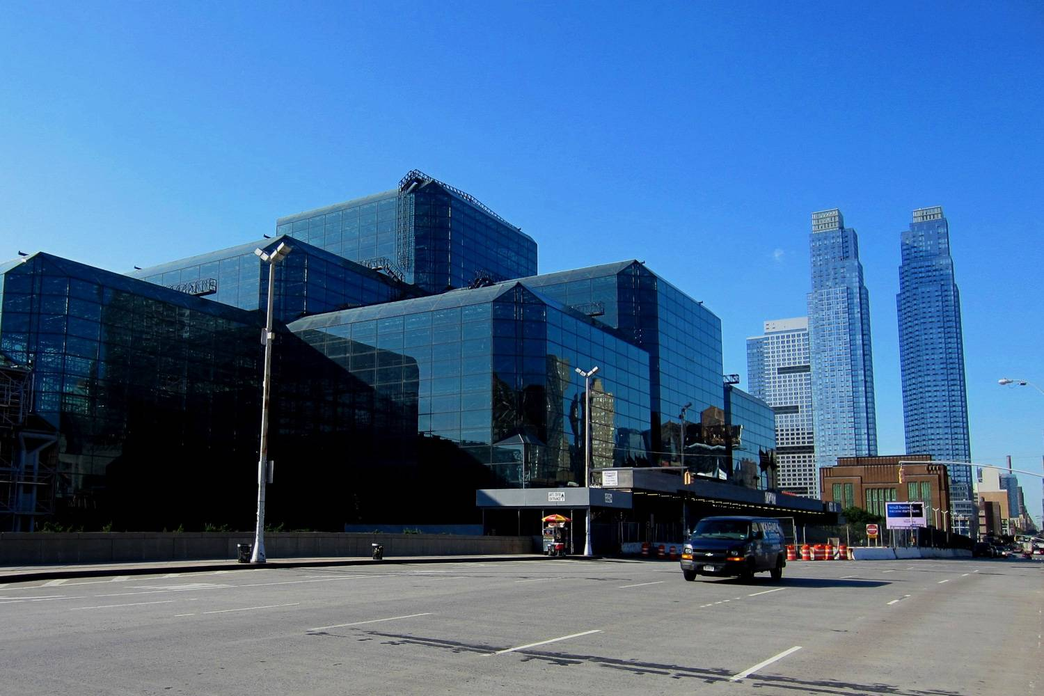 Image of the outside of the Jacob K. Javits Convention Center that is mainly constructed out of blue glass windows.