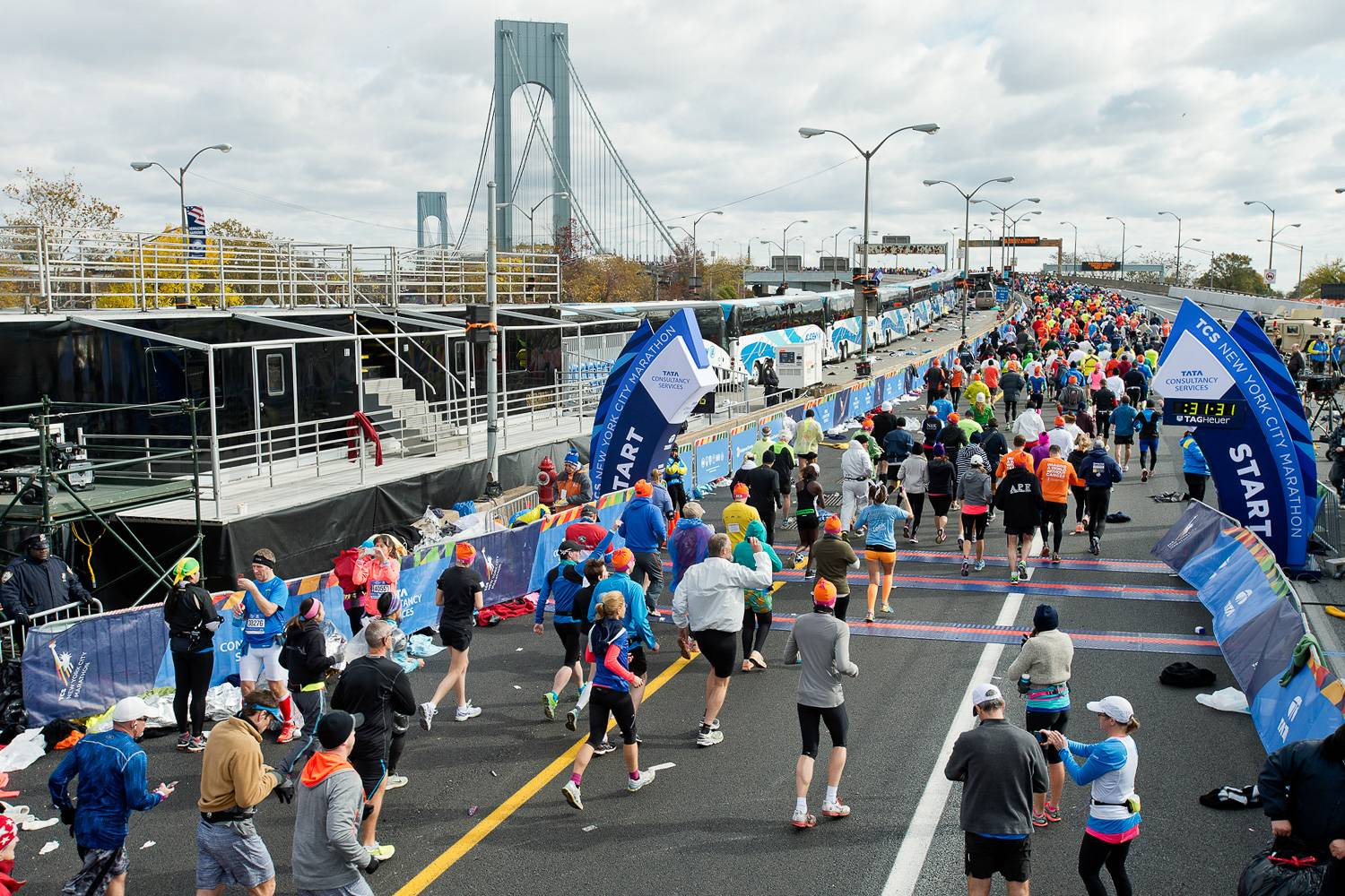 Image of the starting line of the New York City Marathon with the Verrazzano-Narrows Bridge in the background.