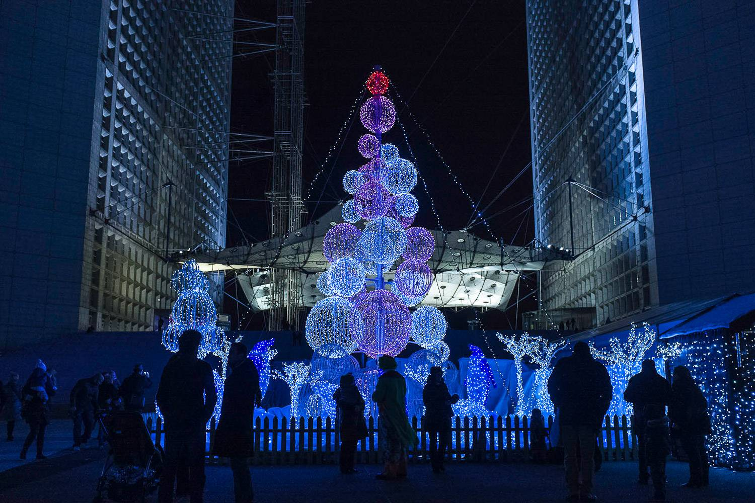 Image of large blue Christmas tree set up at the Grande Arche, Paris
