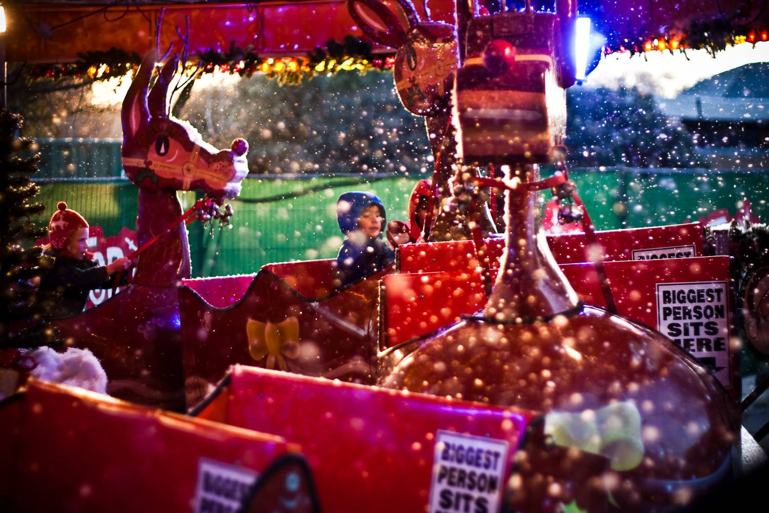 An image of a child riding a reindeer-themed attraction at Hyde Park.