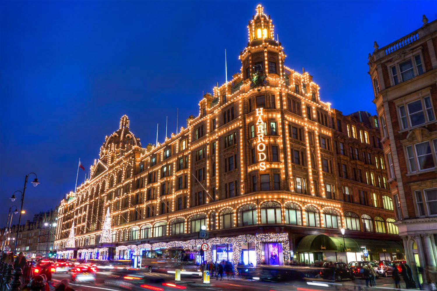 An image of the luxury emporium, Harrods, decorated in festive holiday lights in Knightsbridge, London.