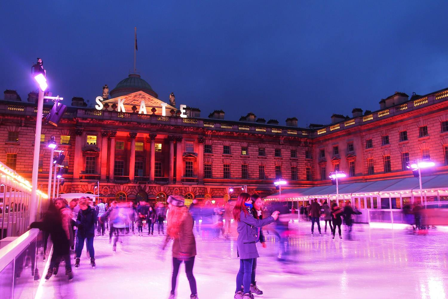 An image of Londoners ice skating at Somerset House.