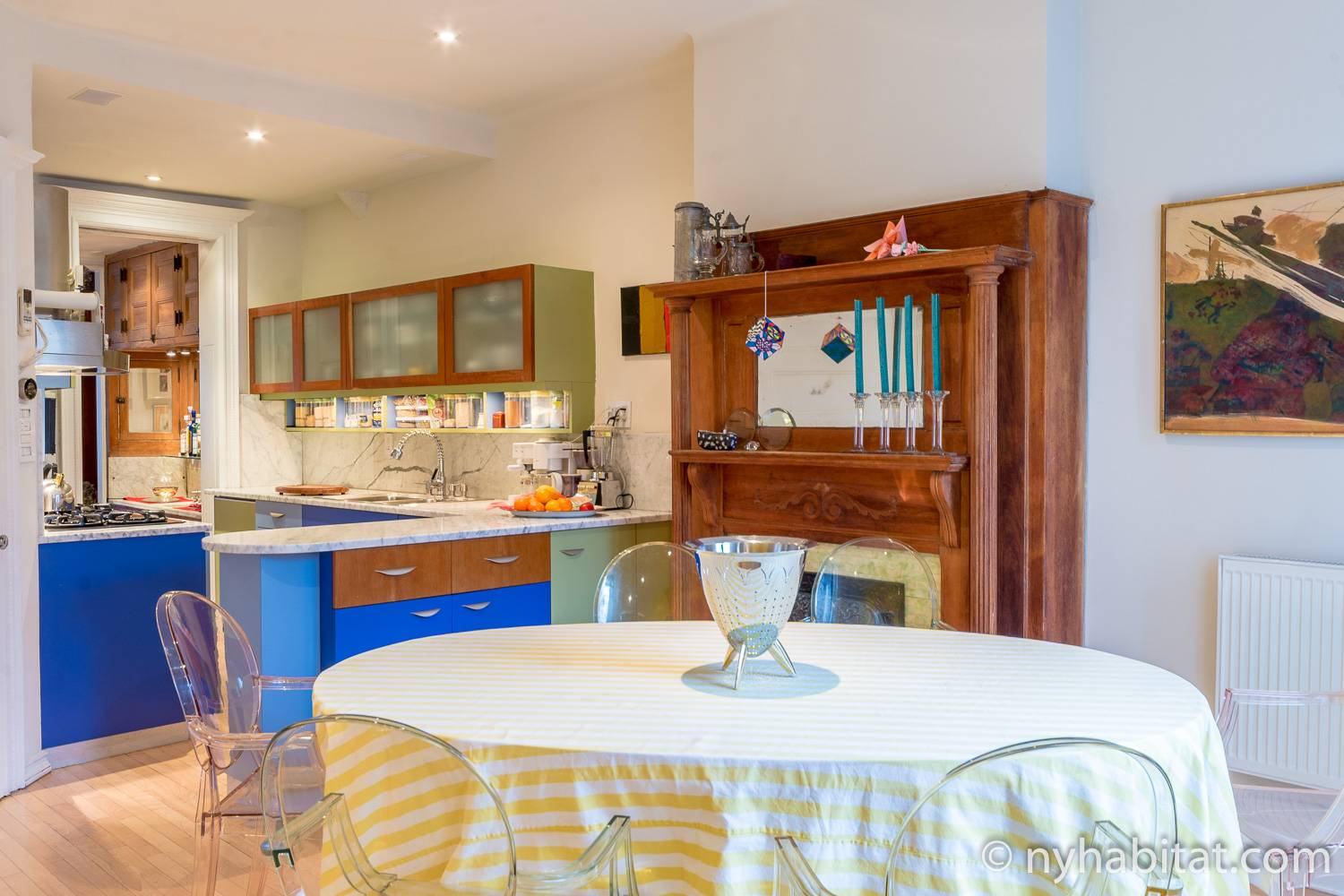 Image of the dining space of Harlem vacation rental NY-12274 next to the modern kitchen decorated with accents of blue and yellow.