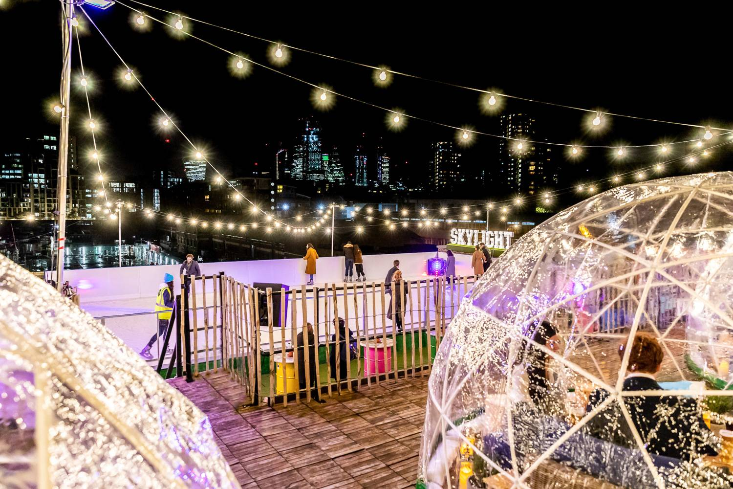 Image of igloors and rooftop ice skating rink at London's Skylight Rooftop Bar.