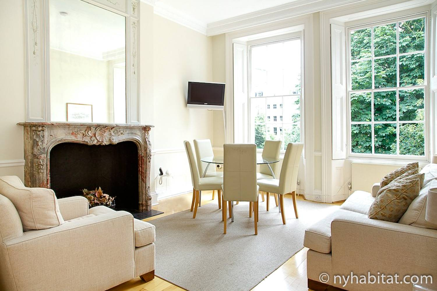 Image of the living room of vacation rental LN-578 in South Kensington, London with a fireplace and comfortable seating.