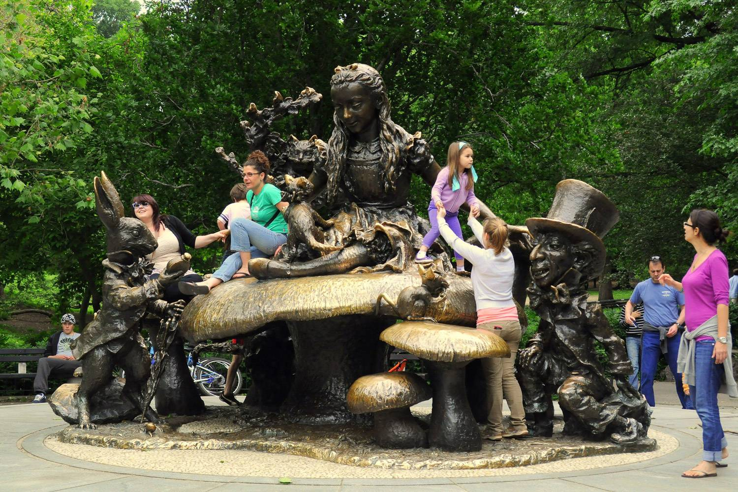 Image of kids climbing on the Alice in Wonderland statue in NYC's Central Park