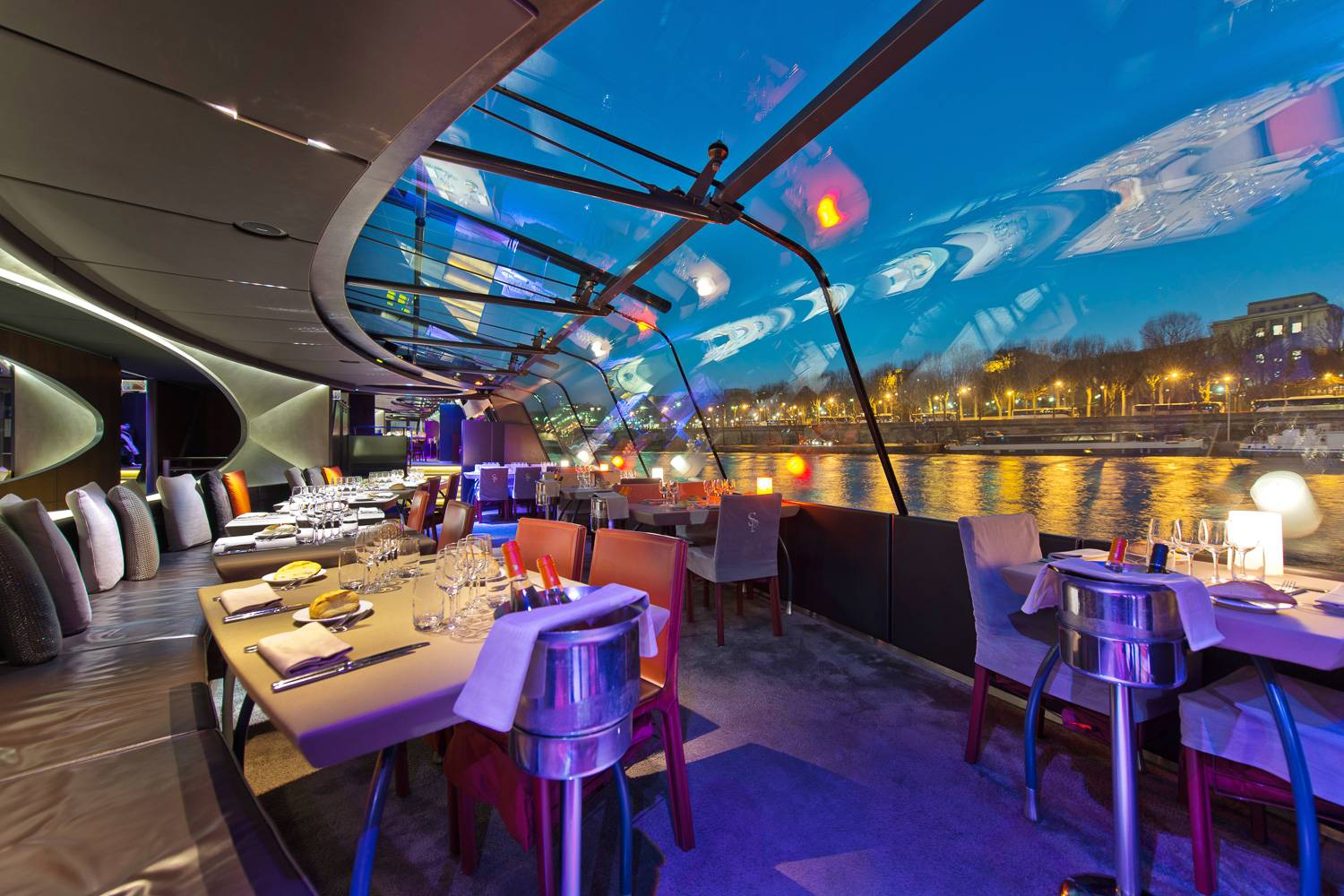 Image of the inside a of dinner cruise on the Seine River in Paris.