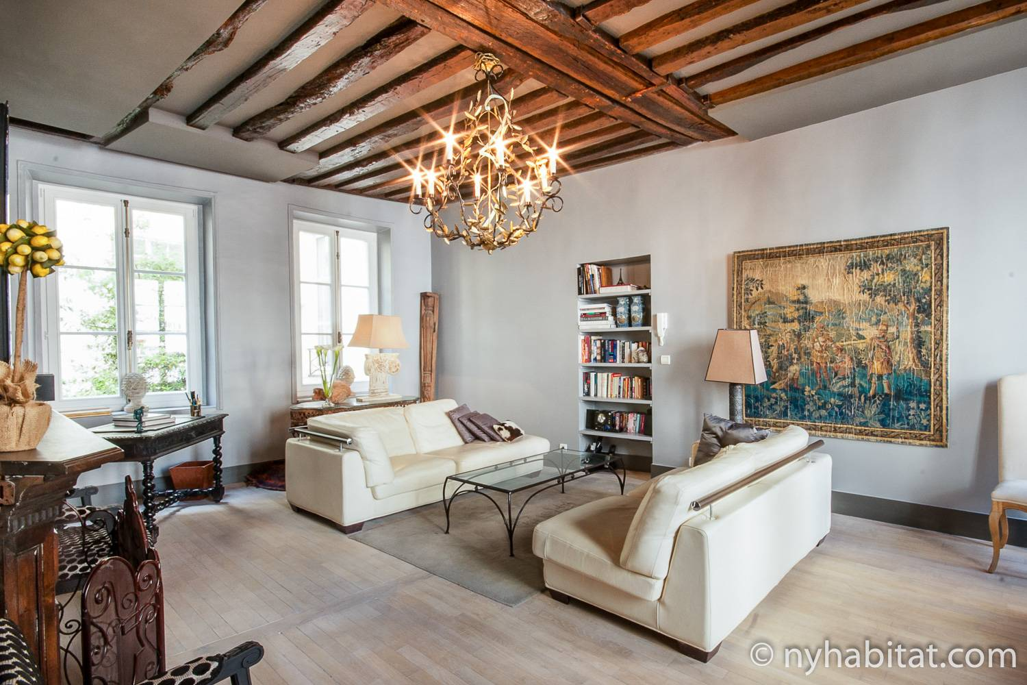 Image of the living room of Le Marais, Paris vacation rental PA-1344 with a chandelier and two couches.