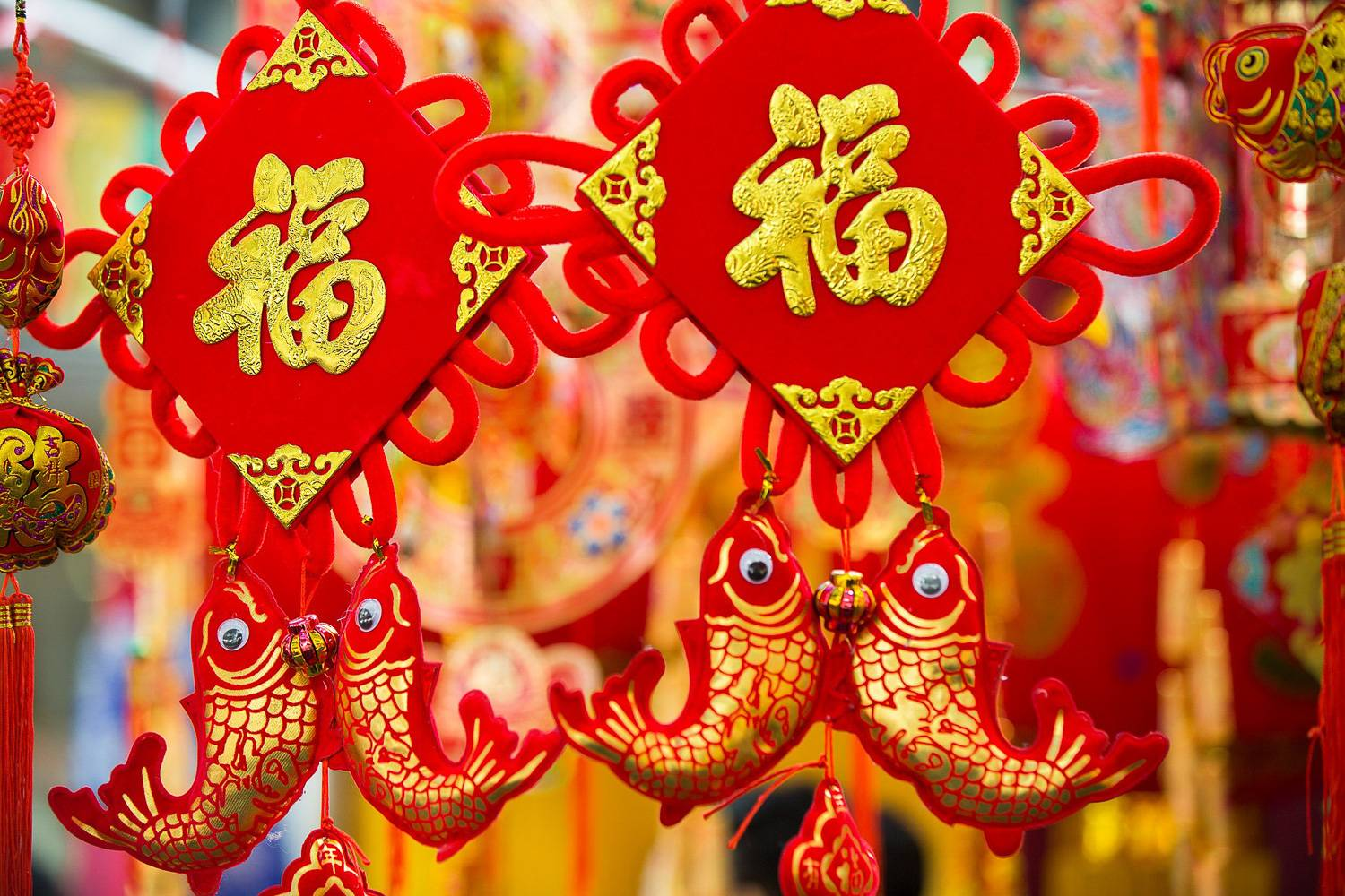 Image of a Chinese decoration hanging with red and gold with fish