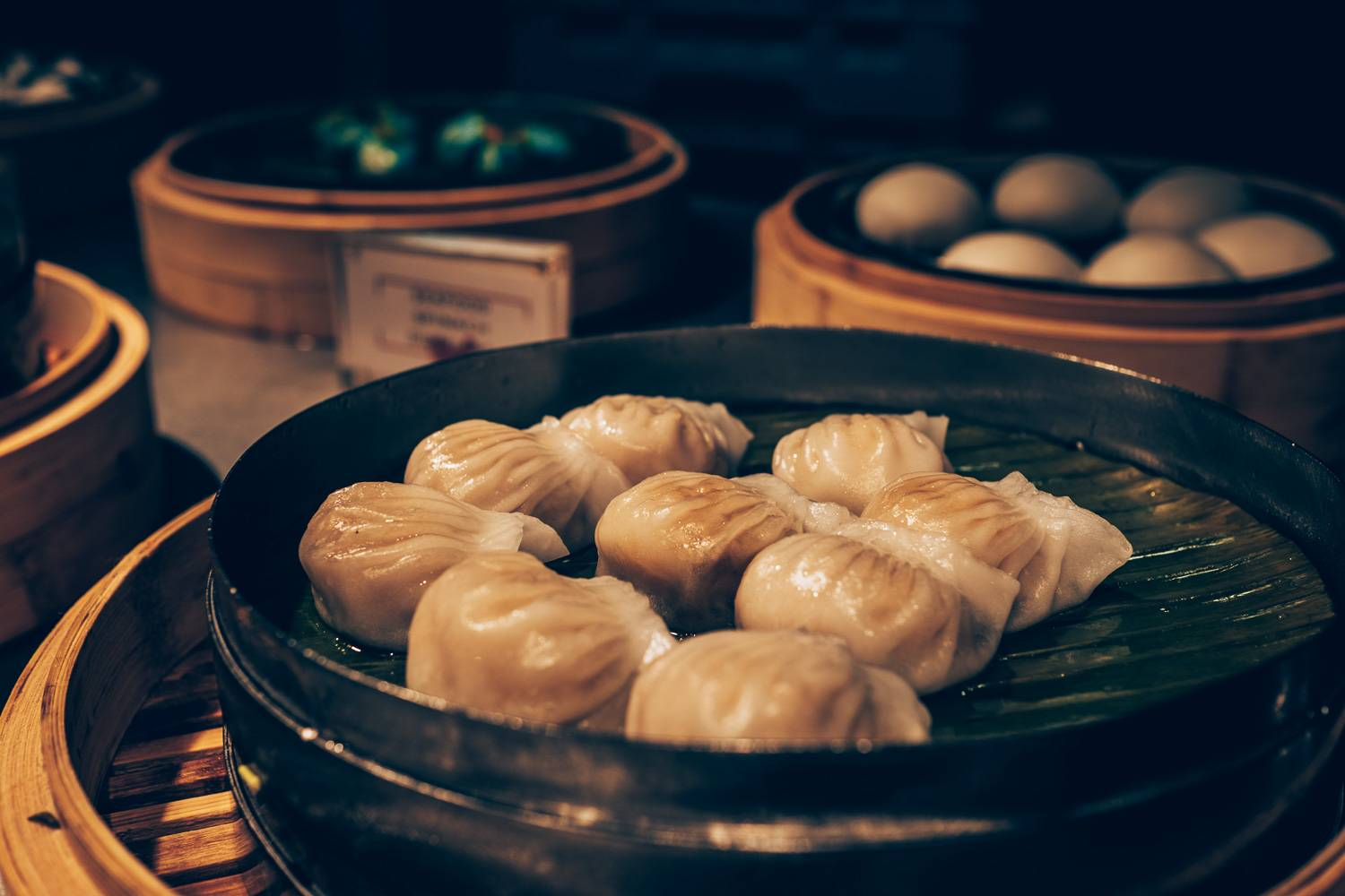 Image of dumplings and Chinese dim sum in steamer boxes