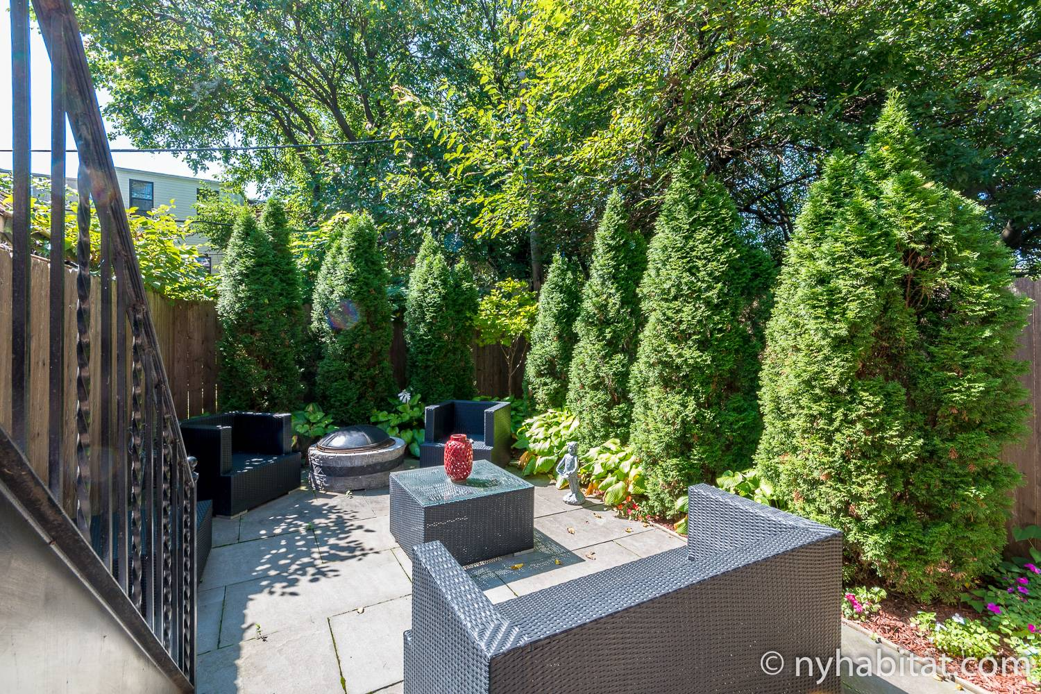 Image of garden with seating and evergreen trees at NY-18025 in Bedford Stuyvesant, Brooklyn