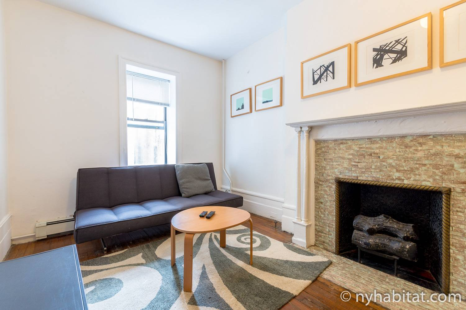 Image of living room of furnished rental NY-927 on Upper West Side with decorative fireplace