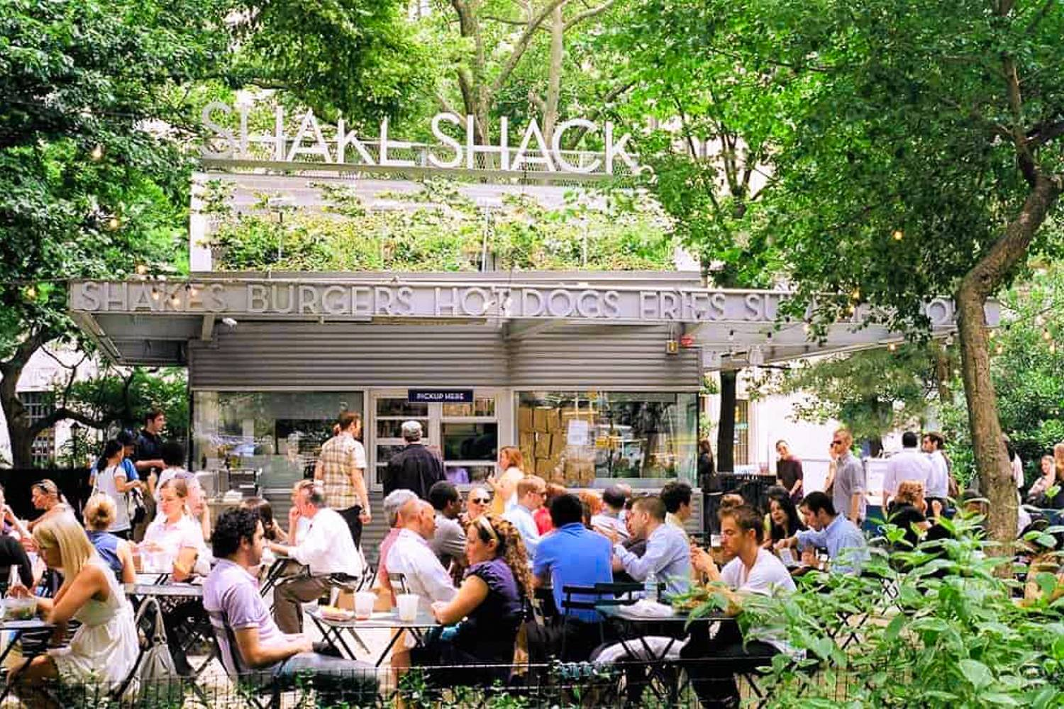 Image of outdoor dining at Shake Shack which has a dog-friendly menu (Image credit: Chelsea Nesvig via Flickr)