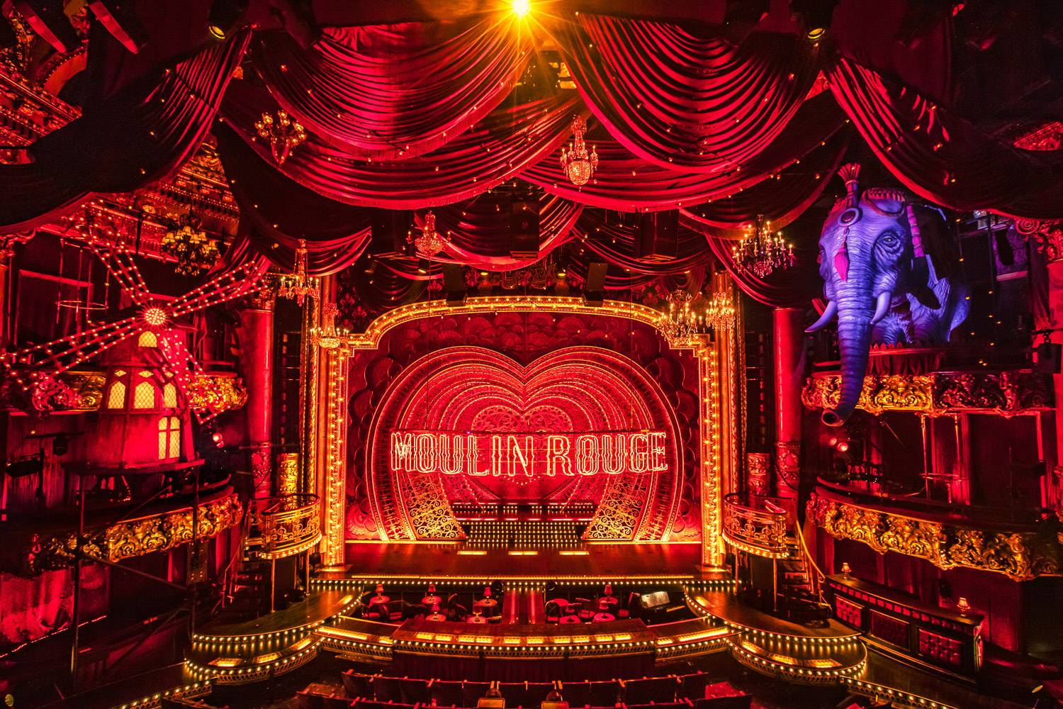 Image of an all-red theater set from Moulin Rouge the Musical