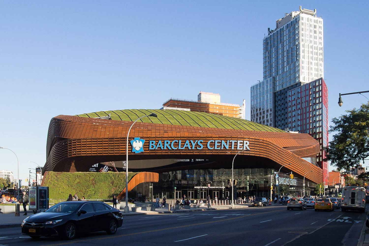 Image of Barclays Center in Brooklyn with a green roof covered in low plants