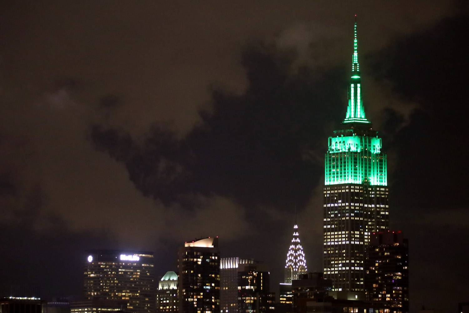 Image of Empire State Building lit up in green for St. Patrick's Day