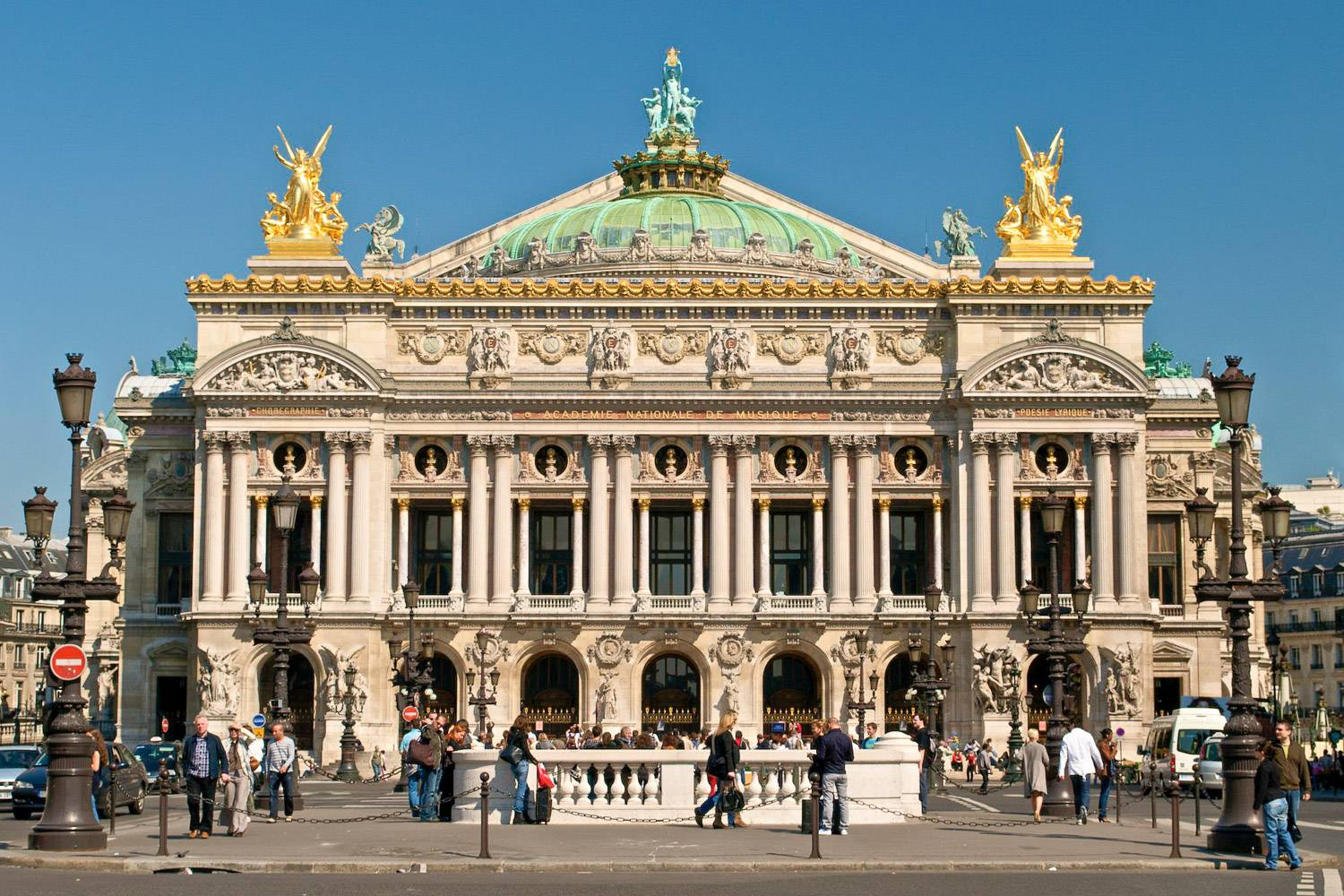 Photo of the Place de l'Opéra in Paris, with people located in front of the impressive Neo-Baroque Garnier Palace.